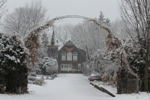 a house covered in snow during winter